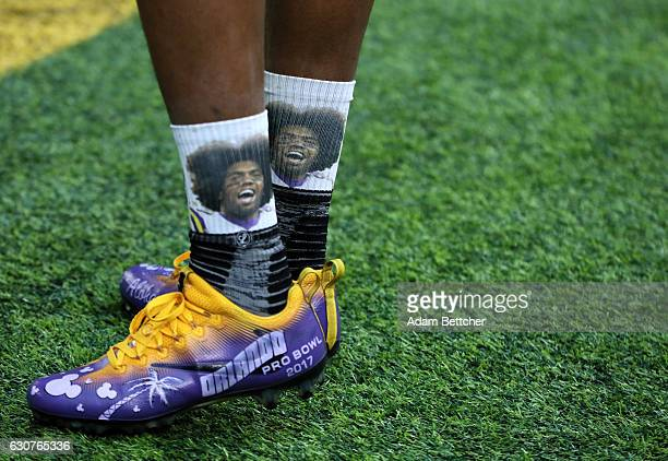 Cordarrelle Patterson of the Minnesota Vikings wears special Pro Bowl Cleats and socks featuring former Minnesota Viking Randy Moss on field before...