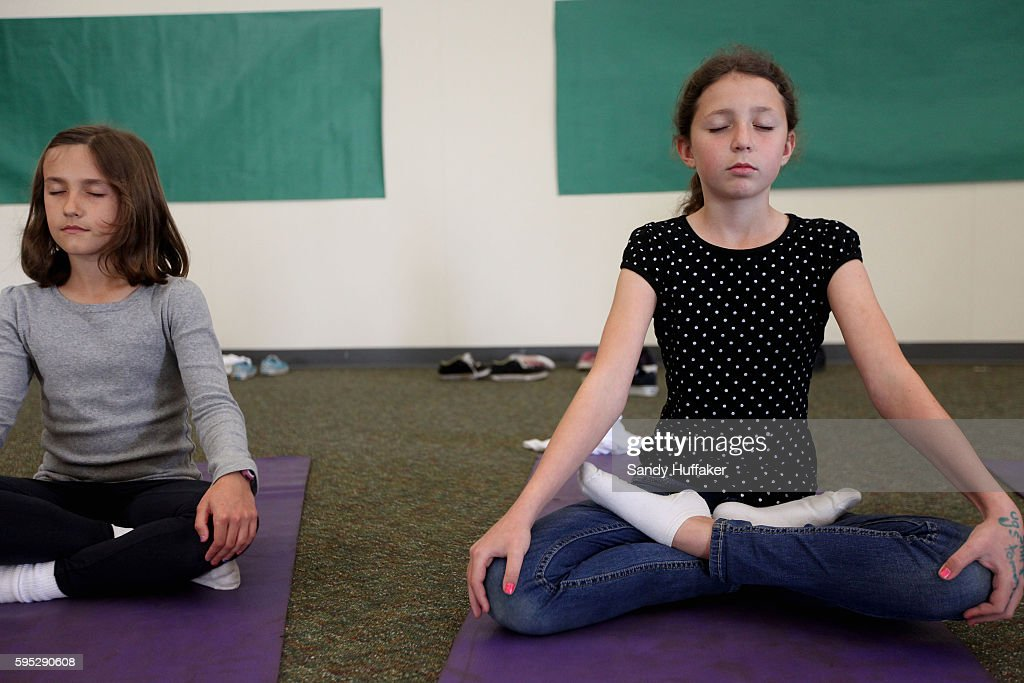 Cordelia DegherR and Dharma SedaGonzalez do breathing exercises during a Yoga at Paul Ecke Central Elementary School in Encinitas CA on Monday March...