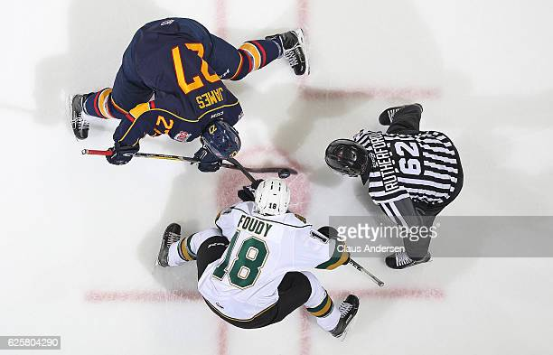 Cordell James of the Barrie Colts takes a faceoff against Liam Foudy of the London Knights during an OHL game at Budweiser Gardens on November 25...