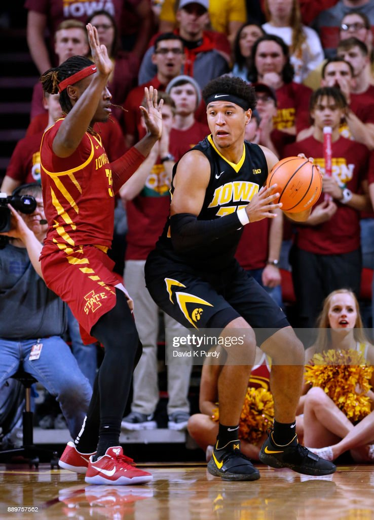 Cordell Pemsl #35 of the Iowa Hawkeyes drives the ball as Solomon Young #33 of the Iowa State Cyclones blocks in the first half of play at Hilton Coliseum on December 7, 2017 in Ames, Iowa.