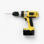 Cordless drill with battery pack attached
