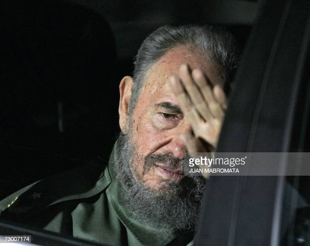 This 20 July 2006 file photo shows Cuban President Fidel Castro waving upon his arrival at airport in Cordoba Argentina to participate in the...