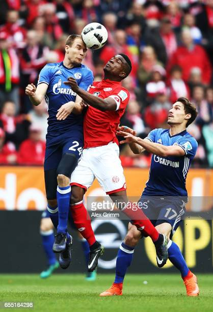 J Cordoba Copete of FSV Mainz 05 challenges Holger Badstuber of Schalke 04 during the Bundesliga match between 1 FSV Mainz 05 and FC Schalke 04 at...