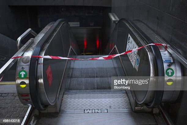 A cordon sits across the top of an escalator at the entrance to a closed underground metro railway station in Brussels Belgium on Monday Nov 23 2015...