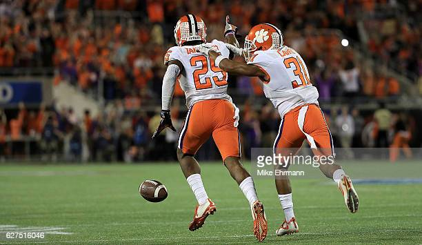 Cordrea Tankersley and Ryan Carter of the Clemson Tigers celebrate winning the ACC Championship on December 3 2016 in Orlando Florida