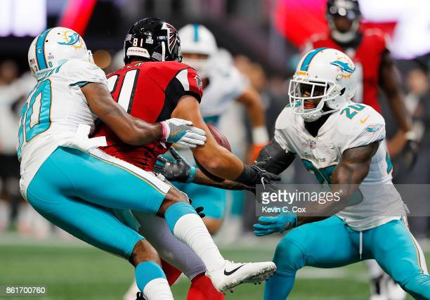Cordrea Tankersley defends as Reshad Jones of the Miami Dolphins intercepts this pass intended for Austin Hooper of the Atlanta Falcons at...