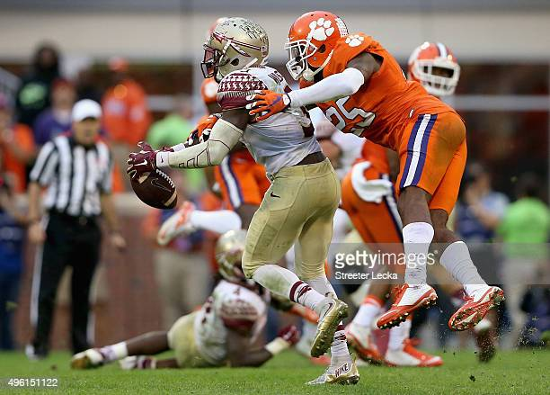 Cordrea Tankersley of the Clemson Tigers knocks the ball away from Jesus Wilson of the Florida State Seminoles during their game at Memorial Stadium...