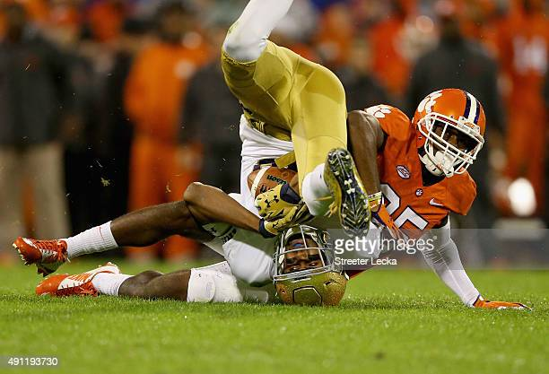 Cordrea Tankersley of the Clemson Tigers tackles Corey Robinson of the Notre Dame Fighting Irish during their game at Clemson Memorial Stadium on...