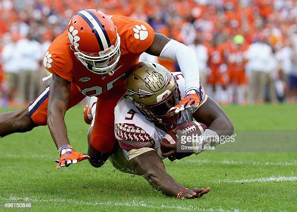 Cordrea Tankersley of the Clemson Tigers tackles Jacques Patrick of the Florida State Seminoles during their game at Memorial Stadium on November 7...