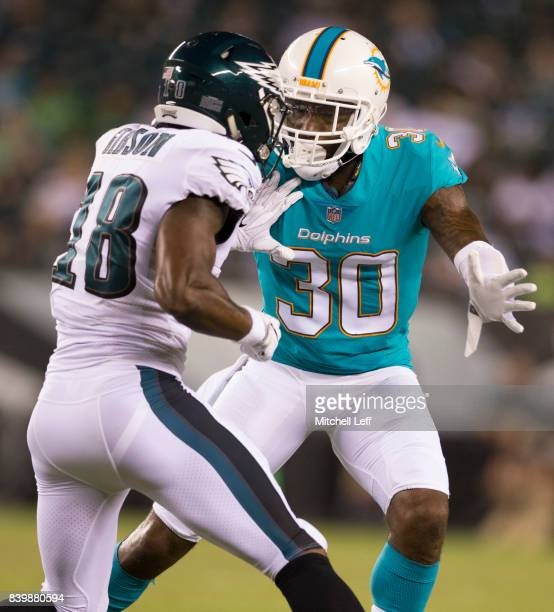 Cordrea Tankersley of the Miami Dolphins covers Shelton Gibson of the Philadelphia Eagles in the preseason game at Lincoln Financial Field on August...