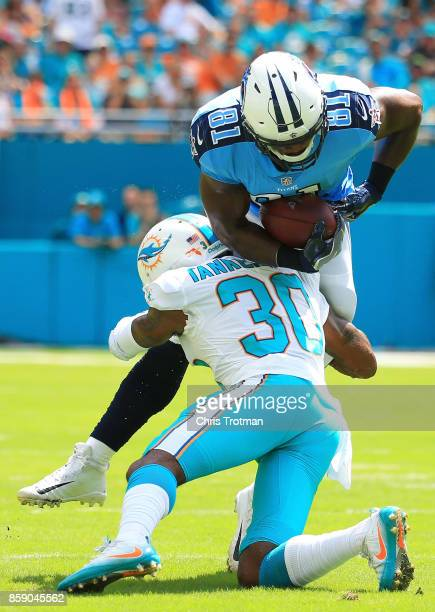 Cordrea Tankersley of the Miami Dolphins tackles Jonnu Smith of the Tennessee Titans in the first quarter on October 8 2017 at Hard Rock Stadium in...