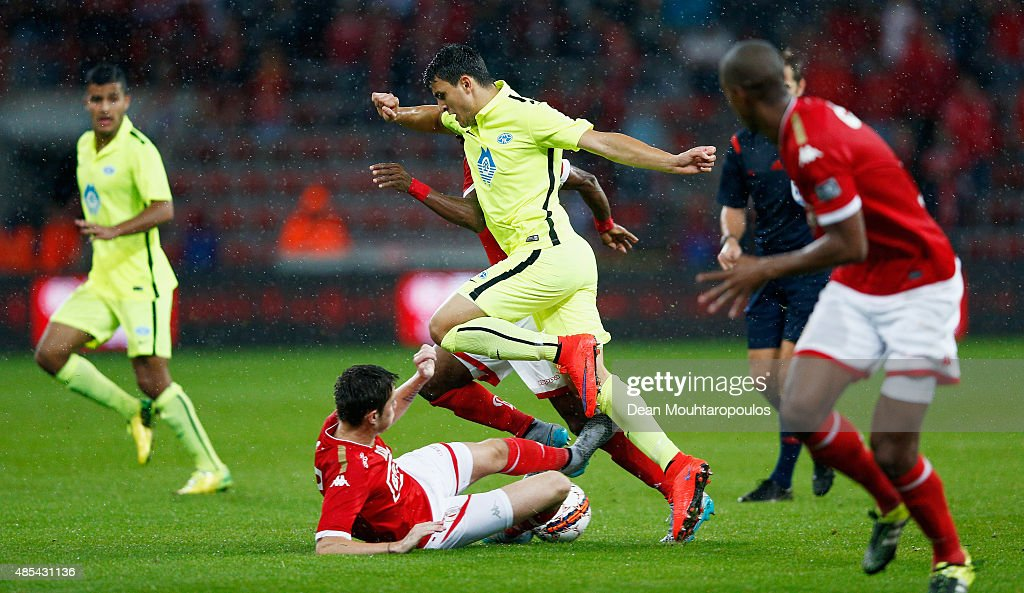 Corentin Fiore of Standard Liege tackles Mohamed Elyounoussi of Molde FK during the UEFA Europa League play off round second leg match between...