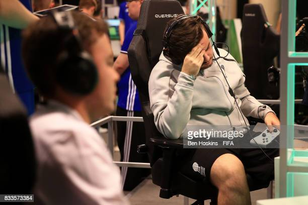 Corentin 'Rockyy' Chevrey of France reacts during his quarter final match against Javier 'Janoz' Munoz of Columbia on day two of the FIFA Interactive...