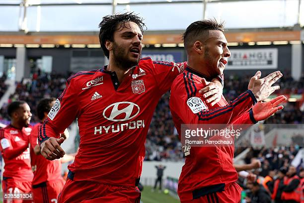 Corentin Tolisso and Clement Grenier of Lyon react after scoring during the French Ligue 1 match between Toulouse and Lyon at Stadium Municipal on...