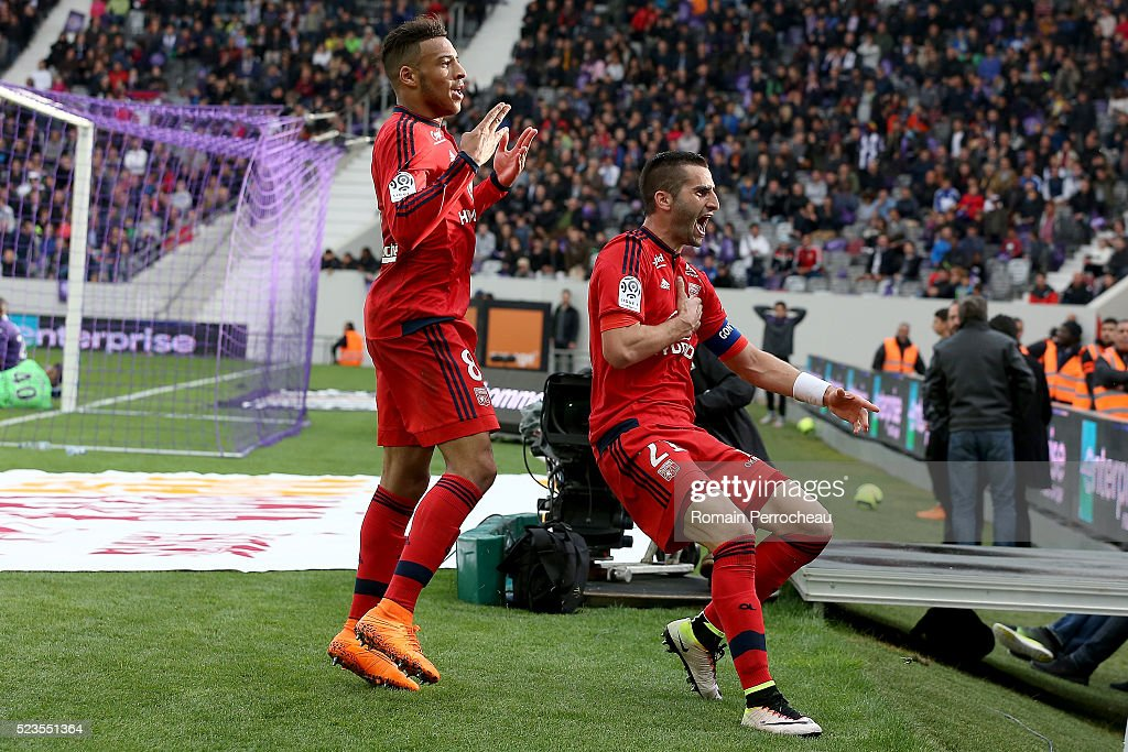 <a gi-track='captionPersonalityLinkClicked' href=/galleries/search?phrase=Corentin+Tolisso&family=editorial&specificpeople=9982829 ng-click='$event.stopPropagation()'>Corentin Tolisso</a> and <a gi-track='captionPersonalityLinkClicked' href=/galleries/search?phrase=Maxime+Gonalons&family=editorial&specificpeople=6256905 ng-click='$event.stopPropagation()'>Maxime Gonalons</a> of Lyon react after scoring during the French Ligue 1 match between Toulouse and Lyon at Stadium Municipal on April 23, 2016 in Toulouse, France.