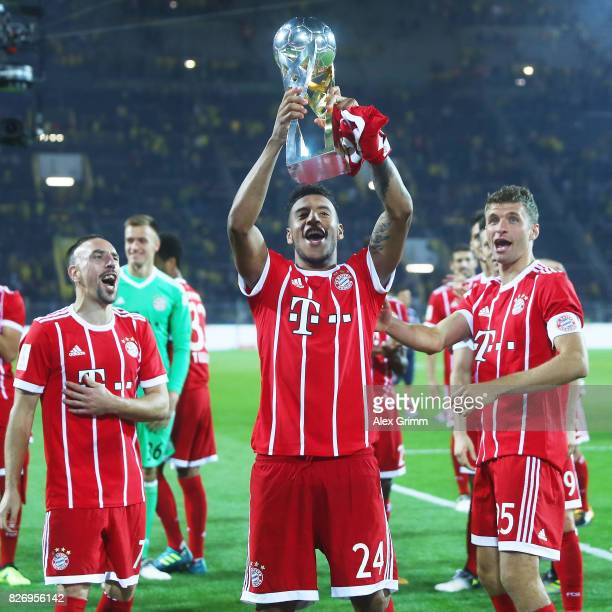 Corentin Tolisso Franck Ribery Thomas Mueller and the team of Bayern Muenchen celebrate with the trophy after winning the DFL Supercup 2017 match...
