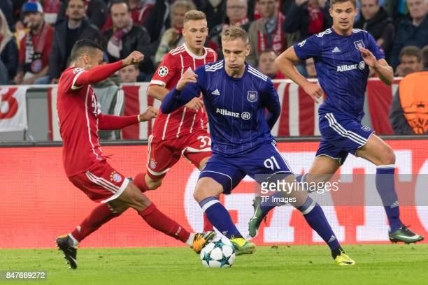 Corentin Tolisso of Bayern Muenchen and Lukasz Teodorczyk of RSC Anderlecht battle for the ball during the UEFA Champions League group B match...