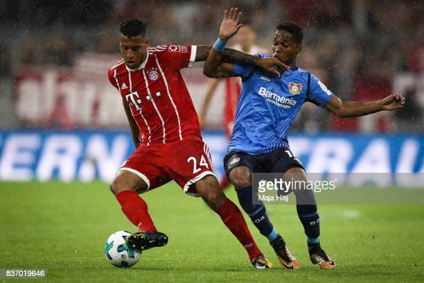 Corentin Tolisso of Bayern Muenchen and Wendell of Leverkusen battle for the ball during the Bundesliga match between FC Bayern Muenchen and Bayer 04...