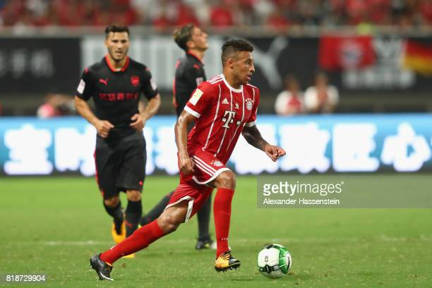 Corentin Tolisso of Bayern Muenchen battles for the ball during the Audi Football Summit 2017 match between Bayern Muenchen and Arsenal FC at...