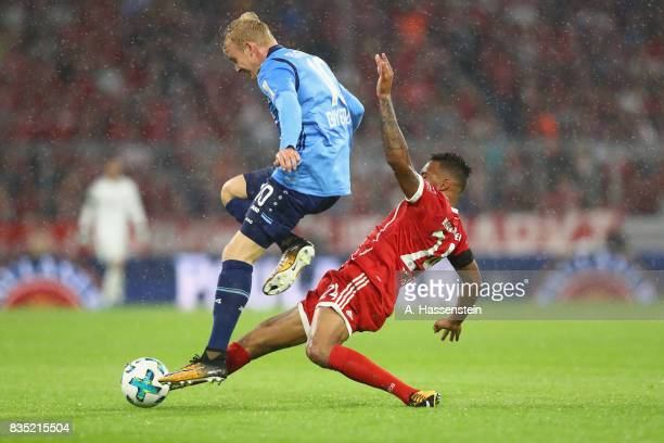 Corentin Tolisso of Bayern Muenchen battles for the ball with Julian Brandt of Leverkusen during the Bundesliga match between FC Bayern Muenchen and...