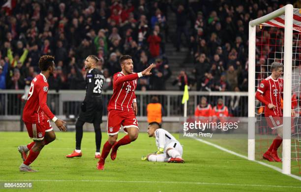 Corentin Tolisso of Bayern Muenchen celebrates after scoring his sides second goal during the UEFA Champions League group B match between Bayern...