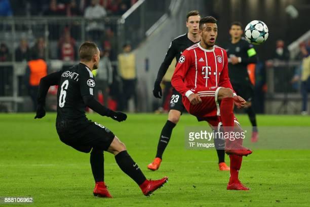 Corentin Tolisso of Bayern Muenchen Marco Verratti of Paris SaintGermain and Julian Draxler of Paris SaintGermain battle for the ball during the UEFA...