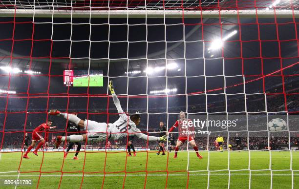Corentin Tolisso of Bayern Muenchen scores his sides second goal past Alphonse Areola of PSG during the UEFA Champions League group B match between...