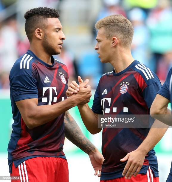 Corentin Tolisso of Bayern Muenchen shakes hands with oshua Kimmich of Bayern Muenchen during the DFB Cup first round match between Chemnitzer FC and...