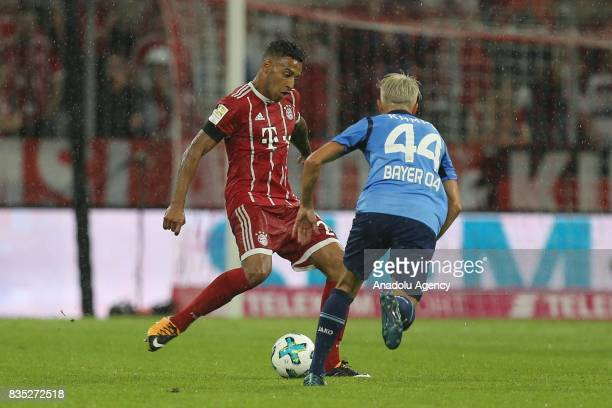 Corentin Tolisso of Bayern Munich and Kevin Kampl of Bayer 04 Leverkusen vie for the ball during the German First division Bundesliga soccer match...