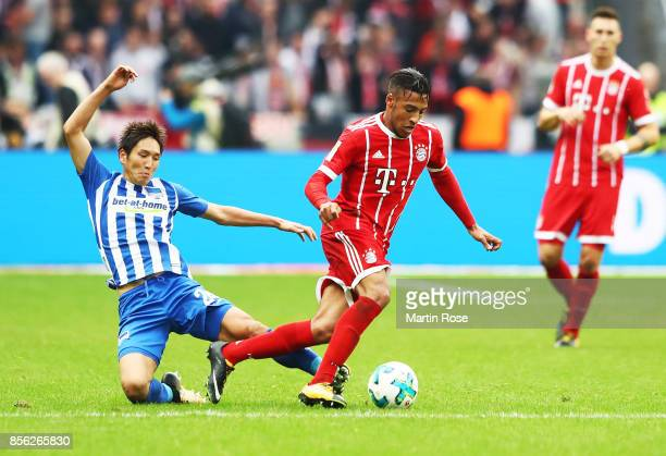 Corentin Tolisso of Bayern Munich is challenged by Genki Haraguchi of Hertha Berlin during the Bundesliga match between Hertha BSC and FC Bayern...