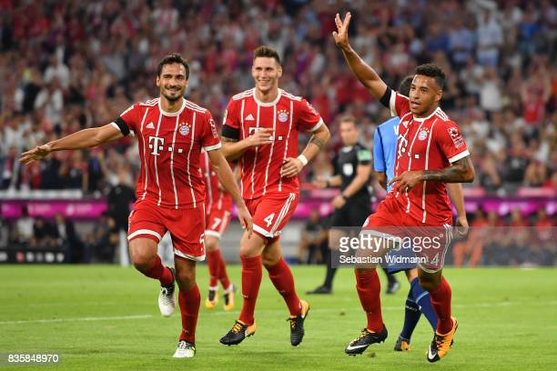 Corentin Tolisso of FC Bayern Muenchen celebrates his goal with teammates Mats Hummels and Niklas Suele during the Bundesliga match between FC Bayern...