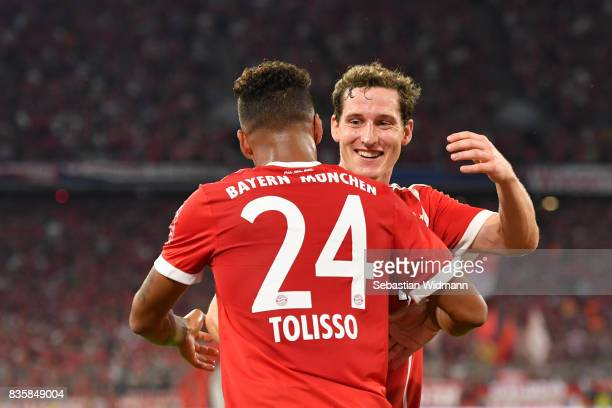 Corentin Tolisso of FC Bayern Muenchen celebrates his goal with teammate Sebastian Rudy during the Bundesliga match between FC Bayern Muenchen and...