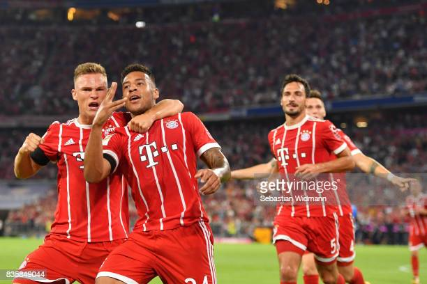 Corentin Tolisso of FC Bayern Muenchen celebrates his goal with teammate Joshua Kimmich during the Bundesliga match between FC Bayern Muenchen and...