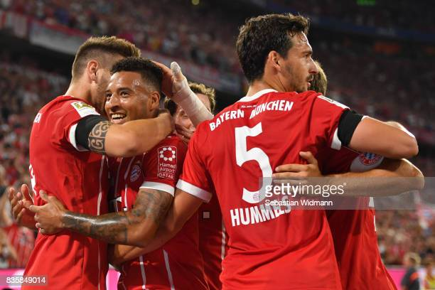 Corentin Tolisso of FC Bayern Muenchen celebrates his goal with teammates during the Bundesliga match between FC Bayern Muenchen and Bayer 04...