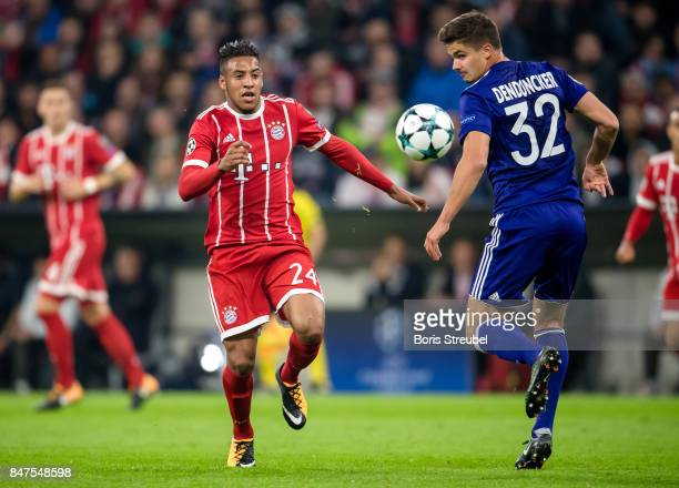 Corentin Tolisso of FC Bayern Muenchen is challenged by Leander Dendoncker of RSC Anderlecht during the UEFA Champions League group B match between...