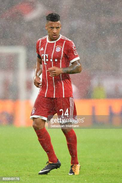 Corentin Tolisso of FC Bayern Muenchen looks on during a heavy rain shower during the Bundesliga match between FC Bayern Muenchen and Bayer 04...