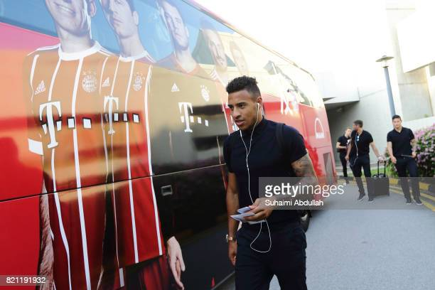 Corentin Tolisso of FC Bayern Muenchen prepares to board the team bus after arriving at Jet Quay Private Terminal ahead of the International...