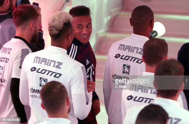 Corentin Tolisso of FC Bayern Muenchen talks to players of Mainz 05 in the players' tunnel before the Bundesliga match between FC Bayern Muenchen and...