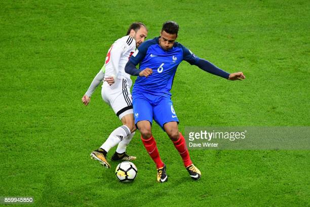 Corentin Tolisso of France and Igor Stasevich of Belarus during the Fifa 2018 World Cup qualifying match between France and Belarus on October 10...