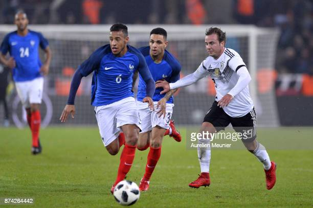 Corentin Tolisso of France and Mario Gotze of Germany fight for the ball during the international friendly match between Germany and France at...