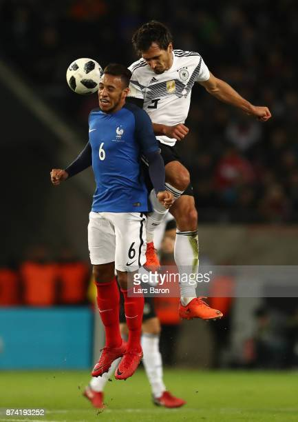 Corentin Tolisso of France and Sami Khedira of Germany battle for possession in the air during the international friendly match between Germany and...