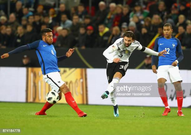 Corentin Tolisso of France attempts to block Marvin Planttenhardt of Germany shot during the international friendly match between Germany and France...