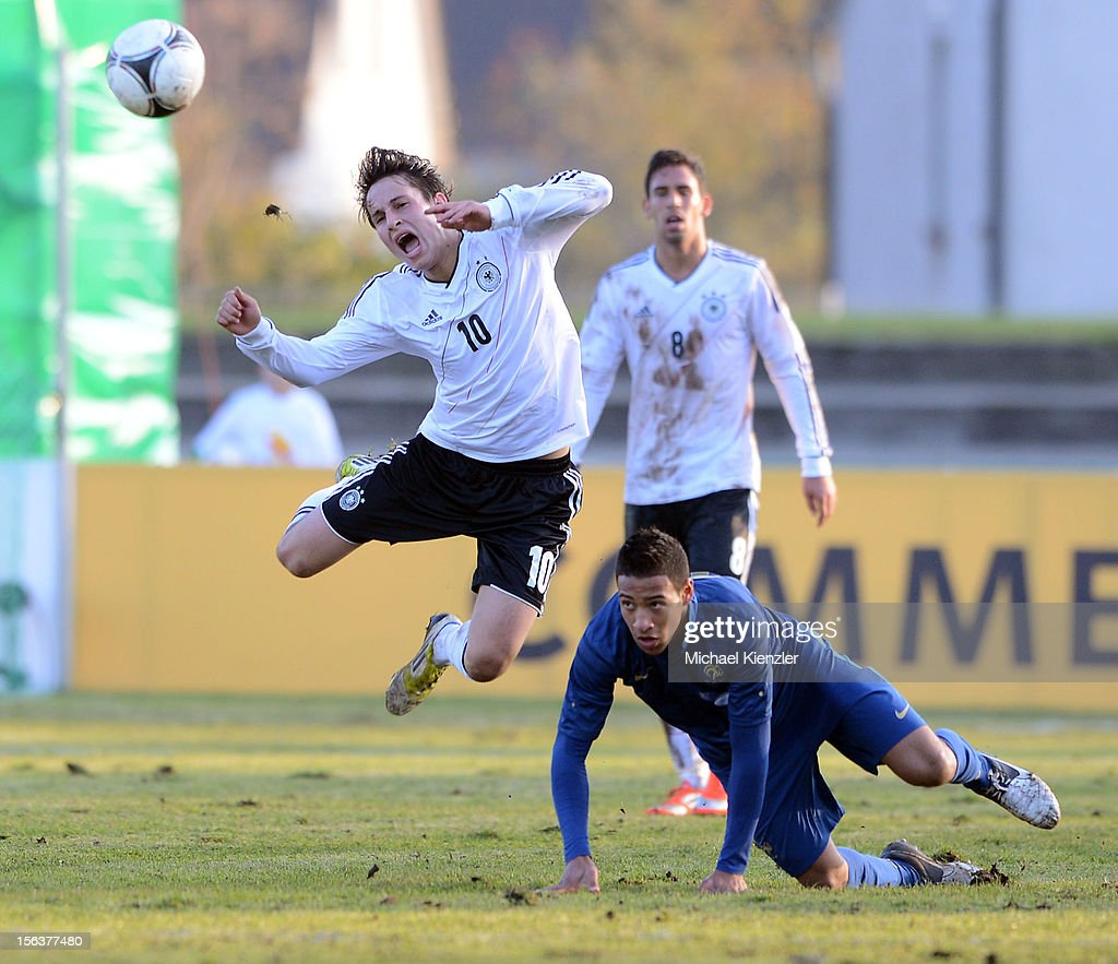 Corentin Tolisso (r) of France challenges Fabian Schnellhardt during the International Friendly match between U19 Germany and U19 France at Rheinstadium on November 14, 2012 in Kehl, Germany.