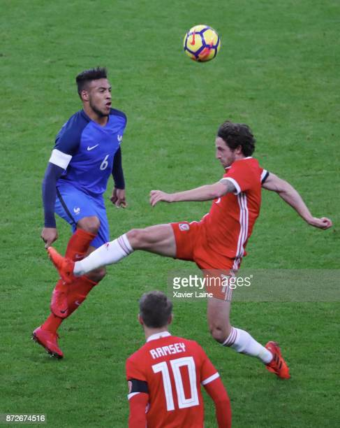 Corentin Tolisso of France in action with Joe Allen of Wales during the friendly match between France and Wales at Stade de France on November 10...