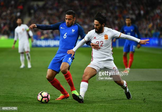 Corentin Tolisso of France is closed down by Isco of Spain during the International Friendly match between France and Spain at Stade de France on...