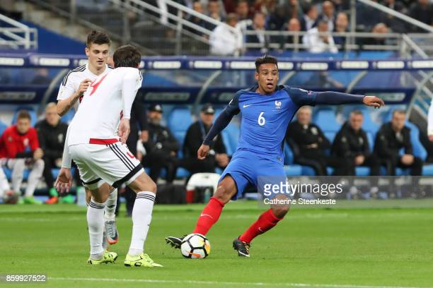 Corentin Tolisso of France looks to pass the ball against Aleksei Yanushkevich of Belarus during the FIFA 2018 World Cup Qualifier between France and...