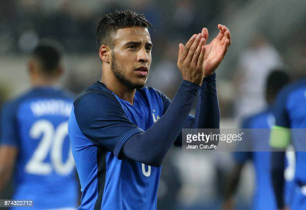 Corentin Tolisso of France salutes the fans following the international friendly match between Germany and France at RheinEnergieStadion on November...