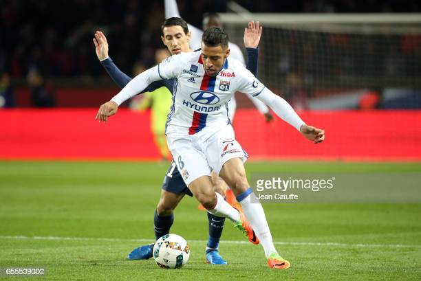 Corentin Tolisso of Lyon and Angel Di Maria of PSG in action during the French Ligue 1 match between Paris SaintGermain and Olympique Lyonnais at...