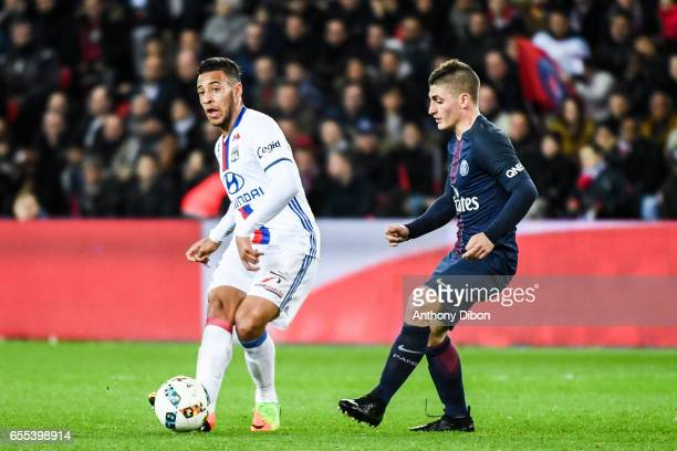 Corentin Tolisso of Lyon and Marco Verratti of PSG during the French Ligue 1 match between Paris Saint Germain and Lyon at Parc des Princes on March...