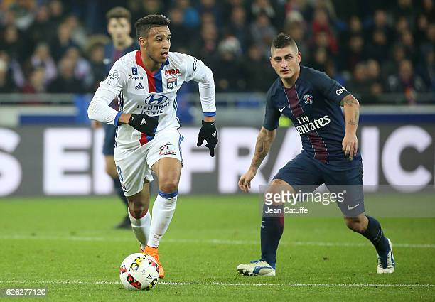 Corentin Tolisso of Lyon and Marco Verratti of PSG in action during the French Ligue 1 match between Olympique Lyonnais and Paris SaintGermain at...